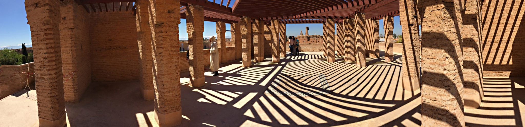 Panorama photo of latticed building with sun light making stripped patterns on ground Corporate Photography Architectural Photography
