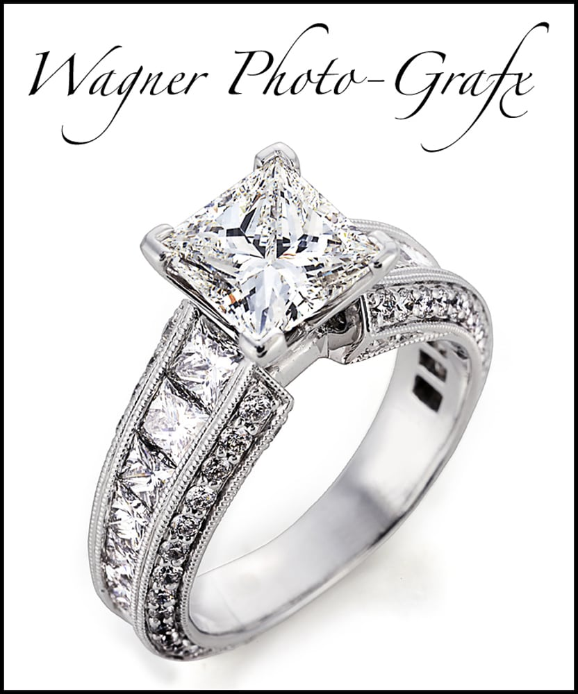 Ornate marquis diamond ring on white with Wagner Photo-Grafx logo above Product Photography
