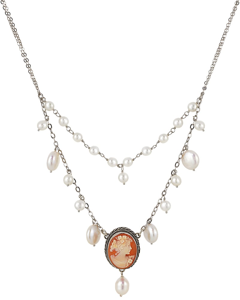 Cameo pendant of girl with flowers in hair on silver chain with pearls all on white background Product Photography