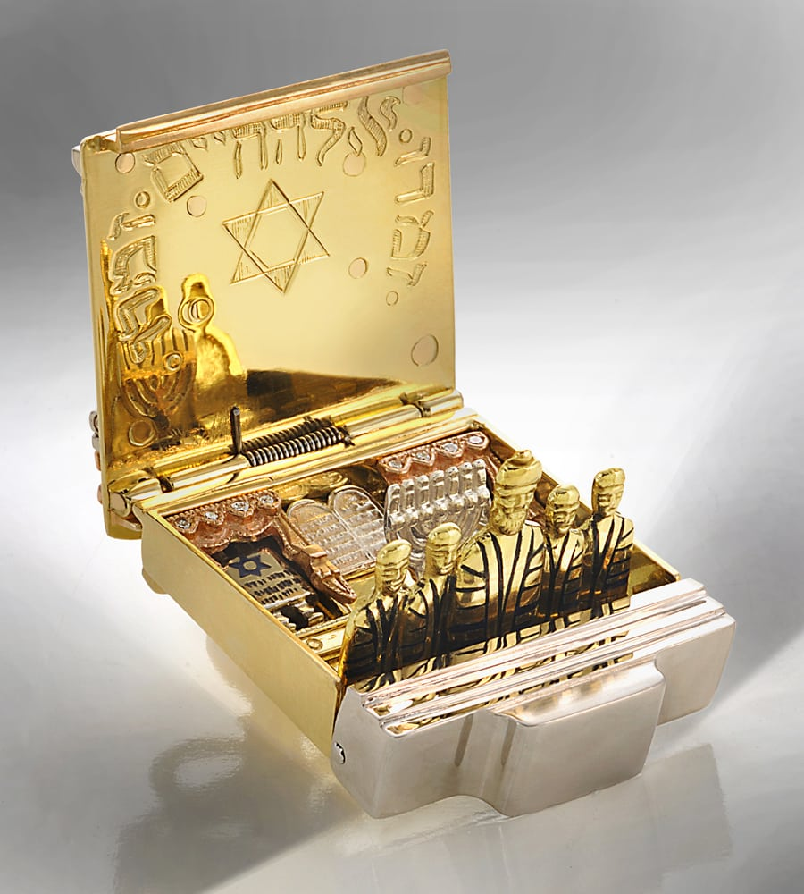 Gold pop open box featuring row of robed men, Rabbi in center and tow on either side, who flip up when opened and Jewish symbols embedded behind including menorah, ten commandments tablets and star of David Product Photography