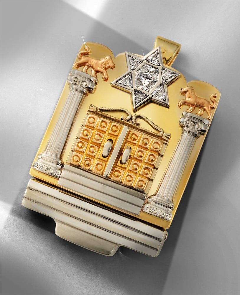 Flip open gold synagogue box pendant outside view featuring ornate doors flanked by silver pillars and a star of David with embedded diamonds Product Photography
