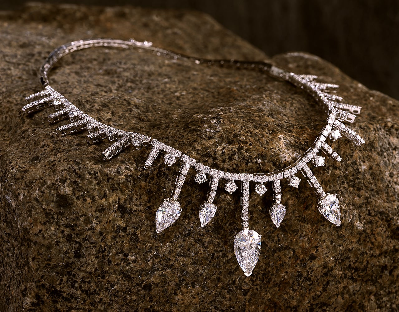 fancy diamond necklace with diamonds surrounding the strand and drops of diamond strands ending with large pear shaped diamonds