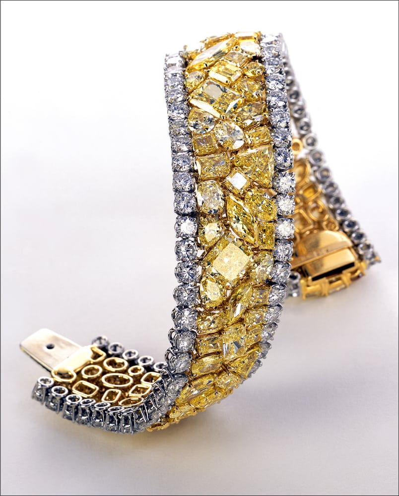 Large diamond bracelet with a Pave of large different shaped yellow diamonds in the middle and white round diamonds bordering it, twisted to stand up. Yellow Brick Road