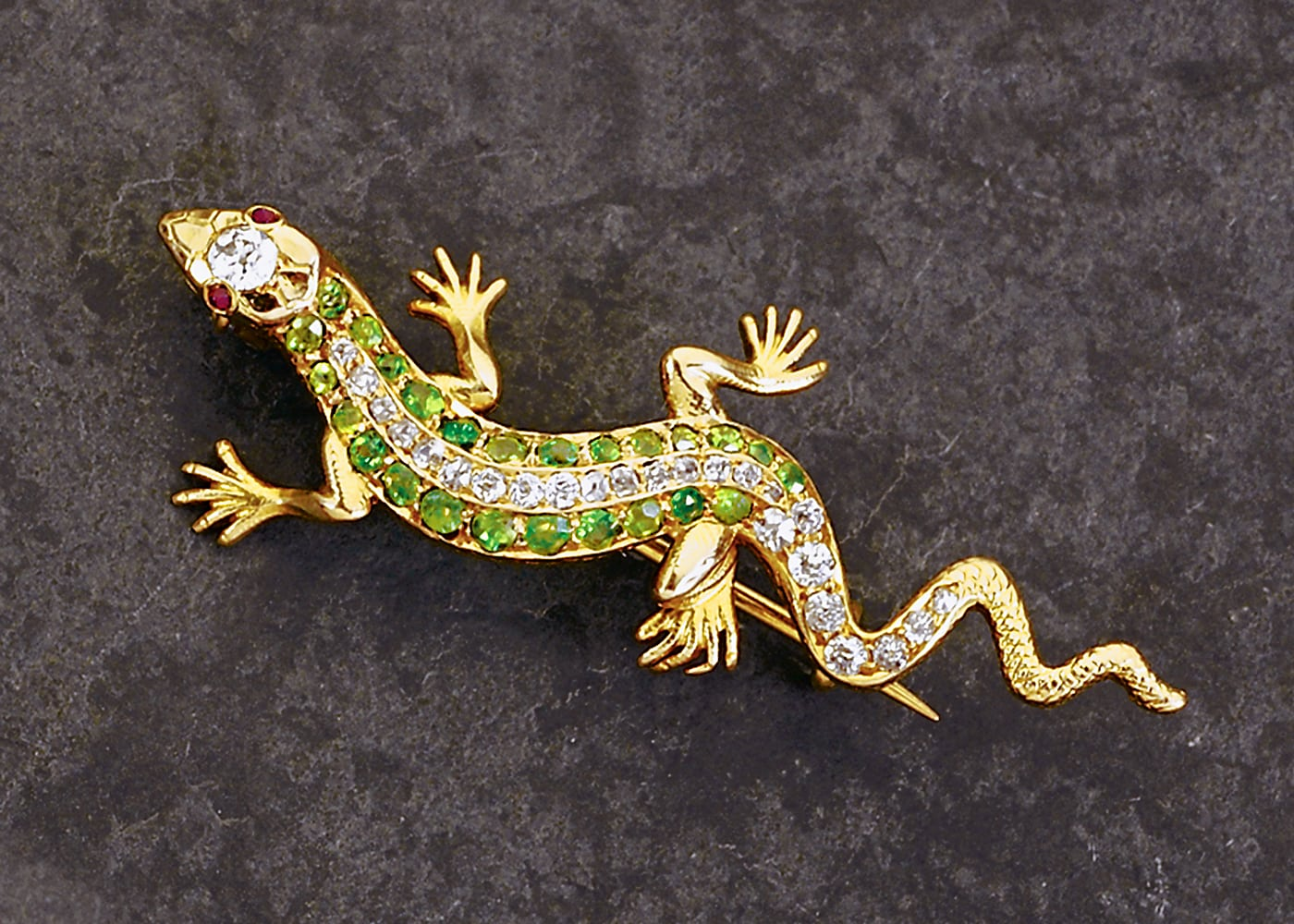 Vintage Geko lizard gold pin with emeralds and diamonds flanking body and ruby eyes and large diamond on head