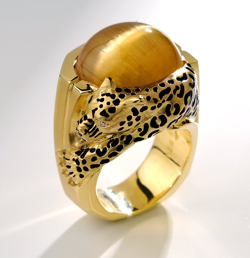 Large museum Tiger Eye stone mounted in gold ring with a leopard sculpted on side with black spots and diamond eyes