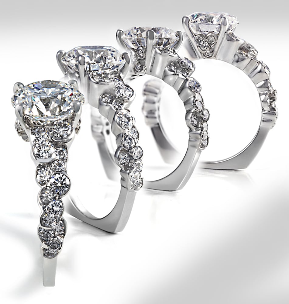 Four views of CumuLLus design diamond platinum ring fanning out to see all angles