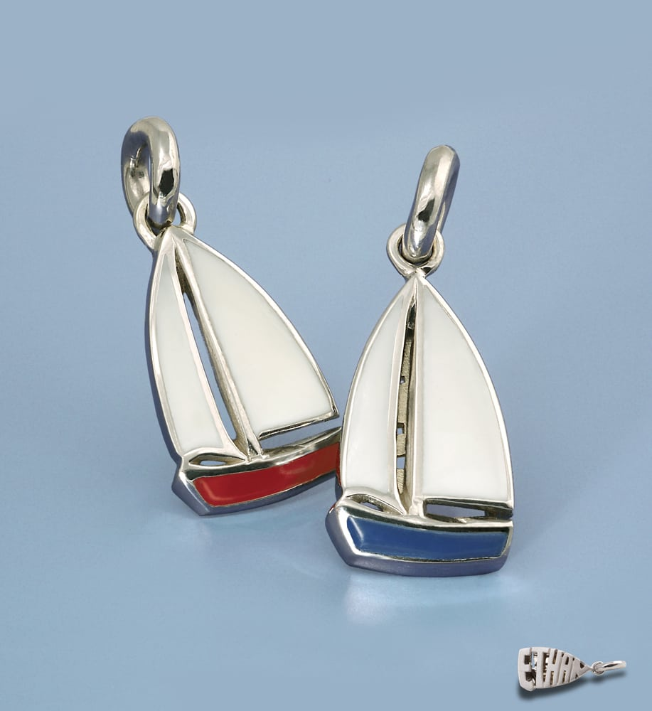"Two enamel sail boat charms sitting up on blue background with ""Ethan"" charm on bottom Product Photography"