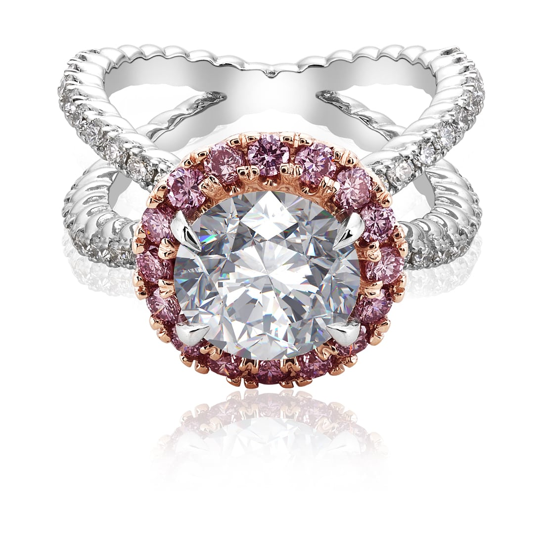 Top angle view of Large round diamond platinum ring with rose gold mounting holding pink diamonds surrounding center stone