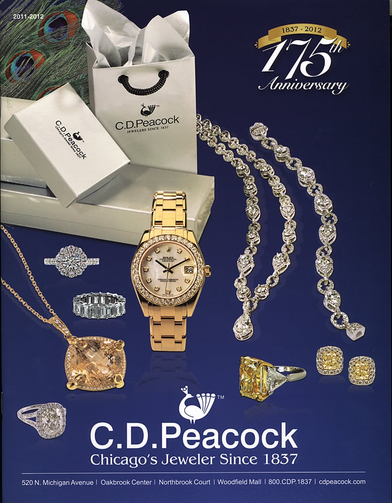 Catalog Cover for CD Peacock Jeweler with fancy jewelry shots in front of packages on blue background Jewelry Photography