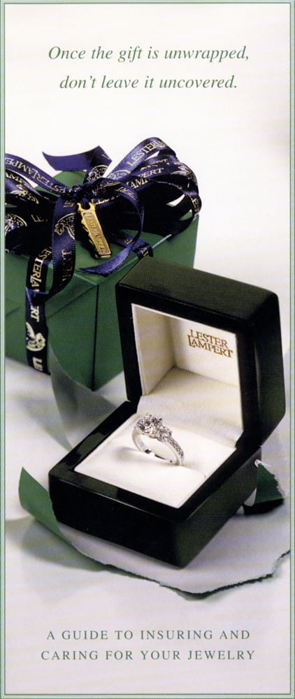Ad Page for Lester Lampert Jewelry product insurance featuring an open ring box with diamond ring and green wrapped box behind. Product Photography