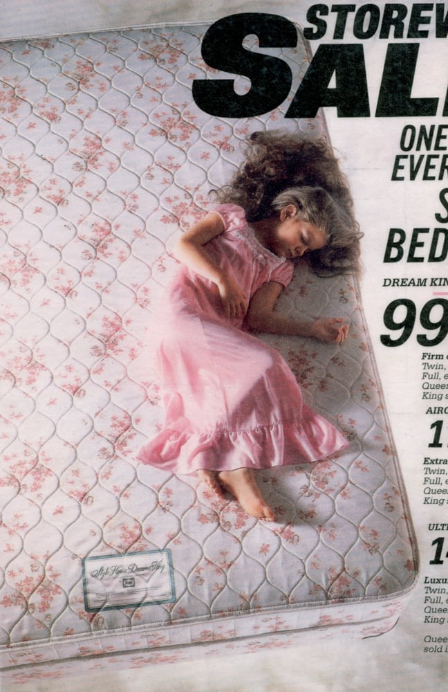 Catalog Page for mattresses featuring a girl model resting on pink loral mattress from above and a cloud look below mattress Product Photography
