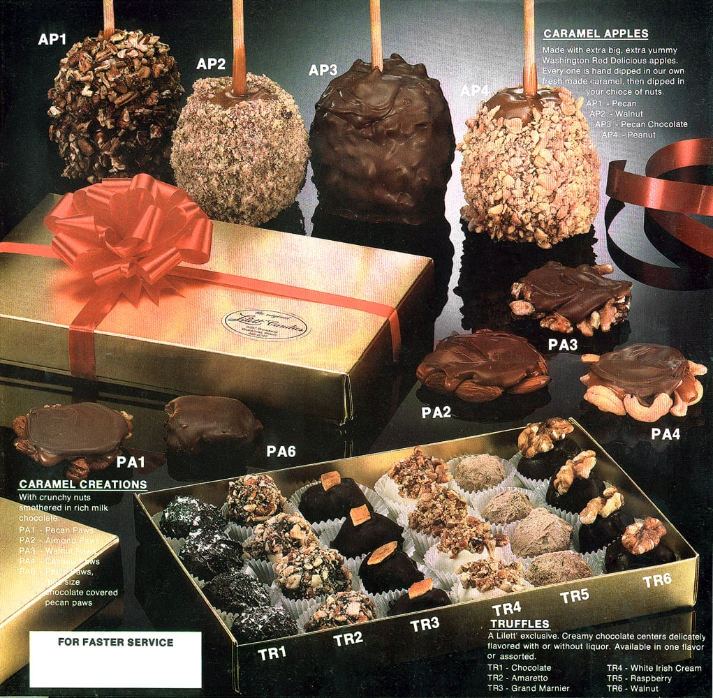 catalog page showing different caramel apples, red ribboned gold gift box, five nut turtles and a box of chocolates on black plexiglass background Product Photography