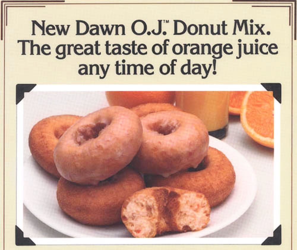 Ad page for Dawn Donuts O.J. Donut Mix featuring product shot of a pile of donuts on white plate, one broken open in front and oranges and a glass of orange juice behind Product Photography