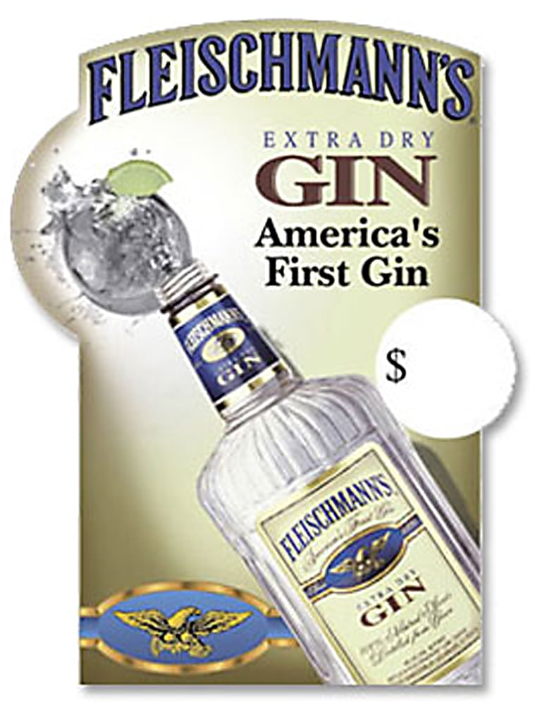 Top view of Large bottle of Fleischmann's Gin pouring into rock glass with splash and lime on ad poster Product Photography