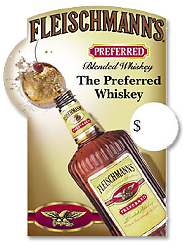 Top view of Large bottle of Fleischmann's Preferred Whiskey pouring into rock glass with splash and cherry on ad poster Product Photography