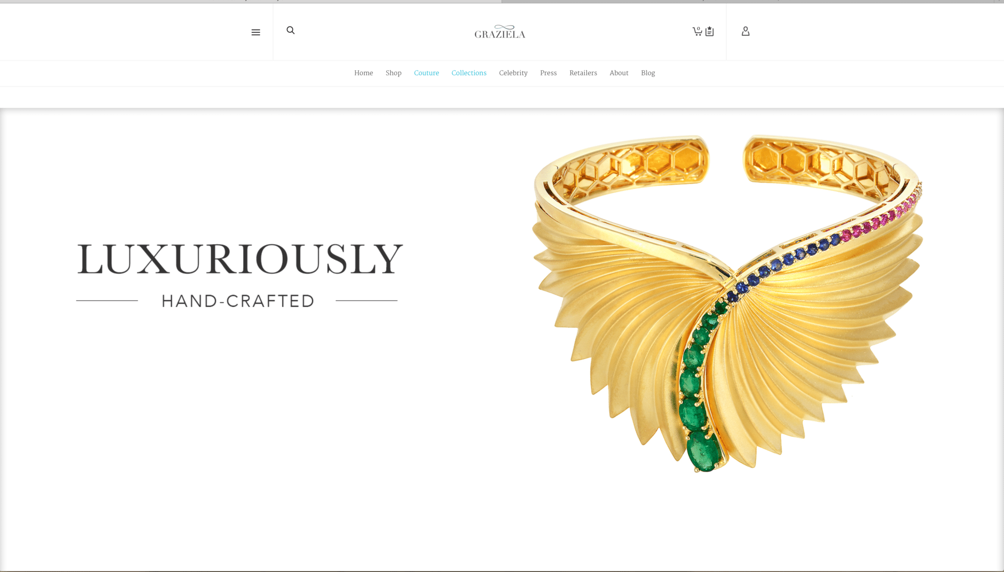 "Ad Page for Graziela Jewelers featuring product shot of a large gold bracelet with a fan design and emeralds, sapphires and rubies running down the center all sitting on white with copy reading"" Luxuriously Hand Crafted"""