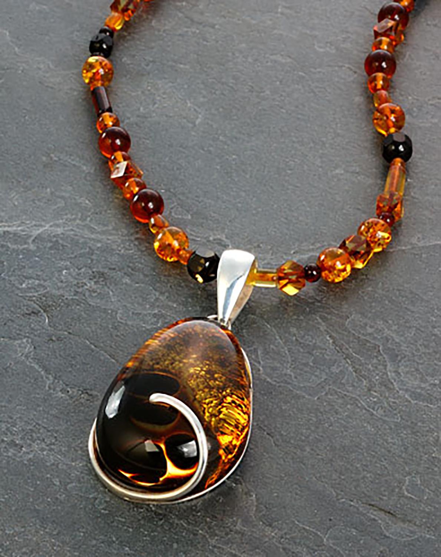 Amber pendant on gray slate background