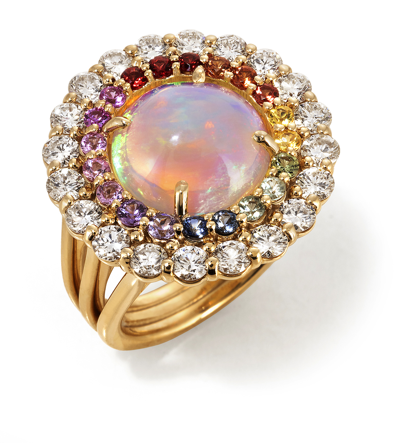 Top view of a three banded gold ring topped with a large reddish opal surrounded by a ring of rainbow colored stones surrounded by a ring of larger diamonds Product Photography