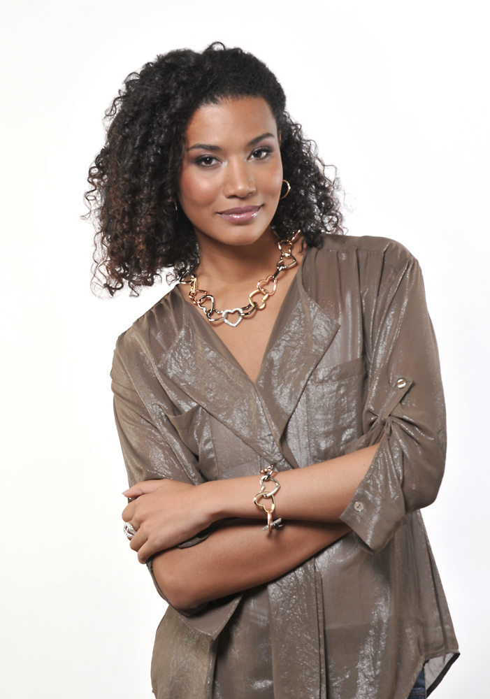 Fashion model on white set with heart jewelry set