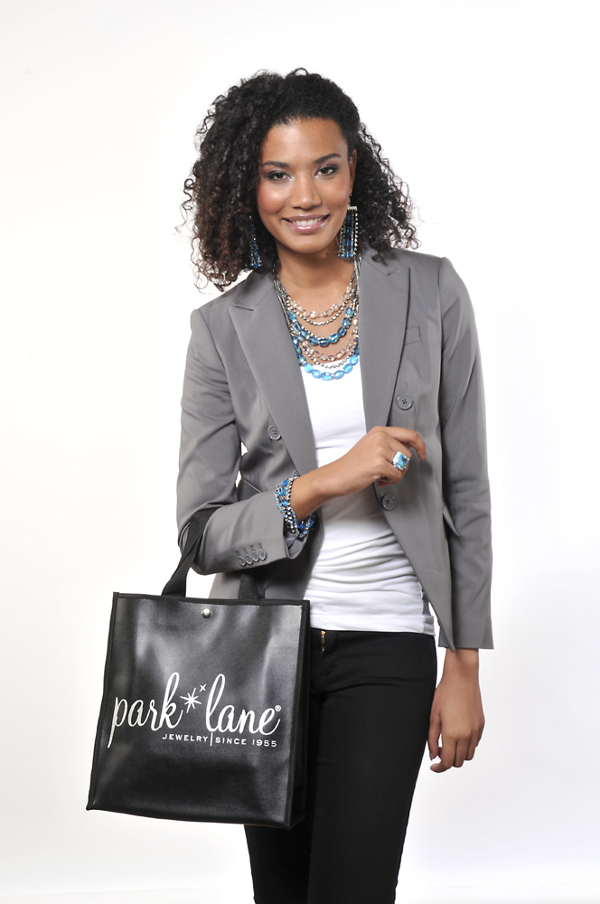 Fashion model on white set with jewelry and bag with Park Lane bag