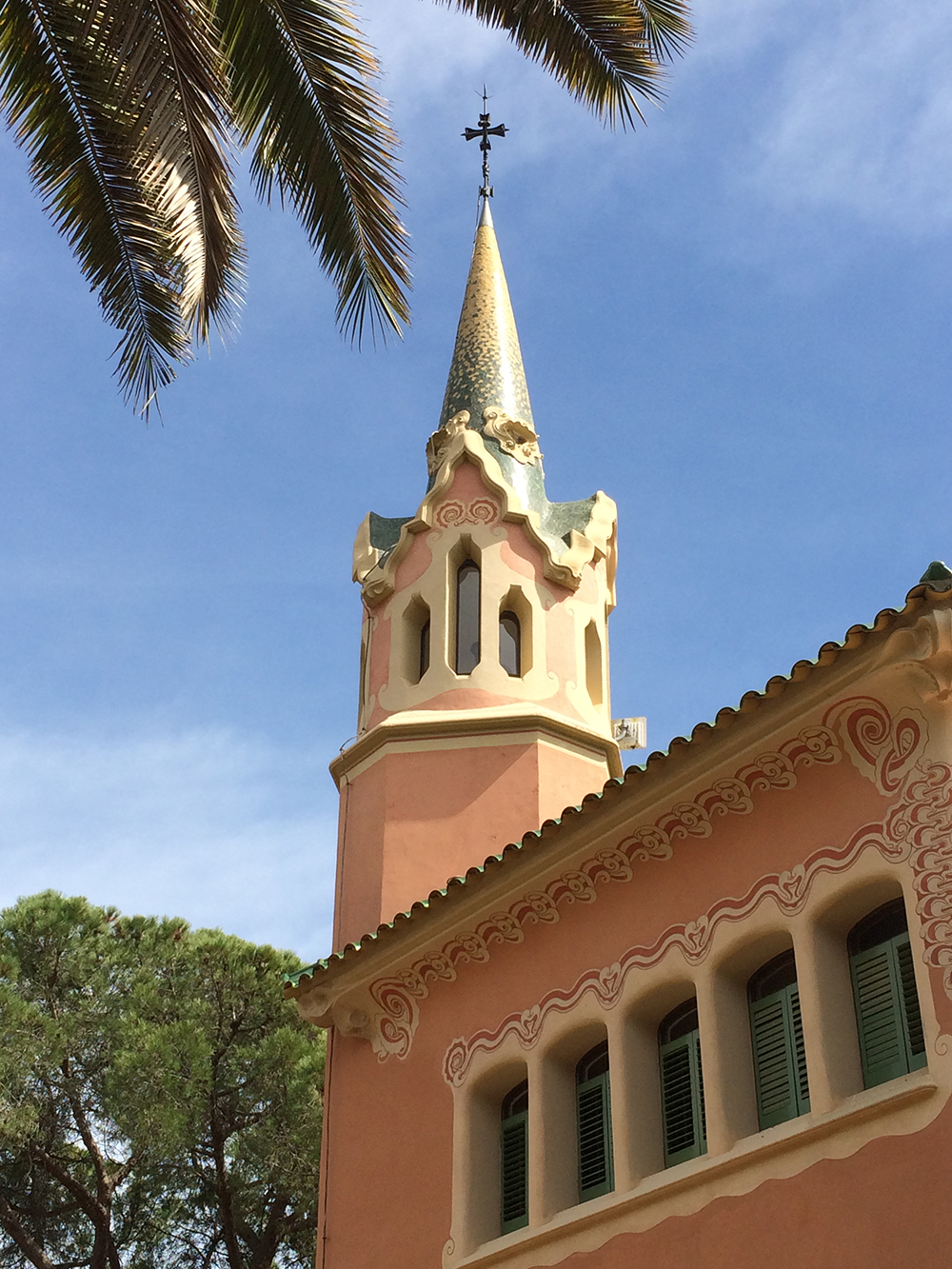 Church sttple in Barcelona Spain with palm tree at top Architectural Photography