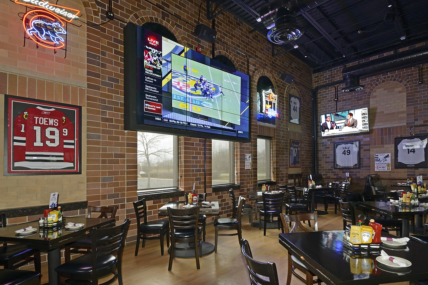Seating area in Sports Bar with large televisions up on walls Architectural Photography
