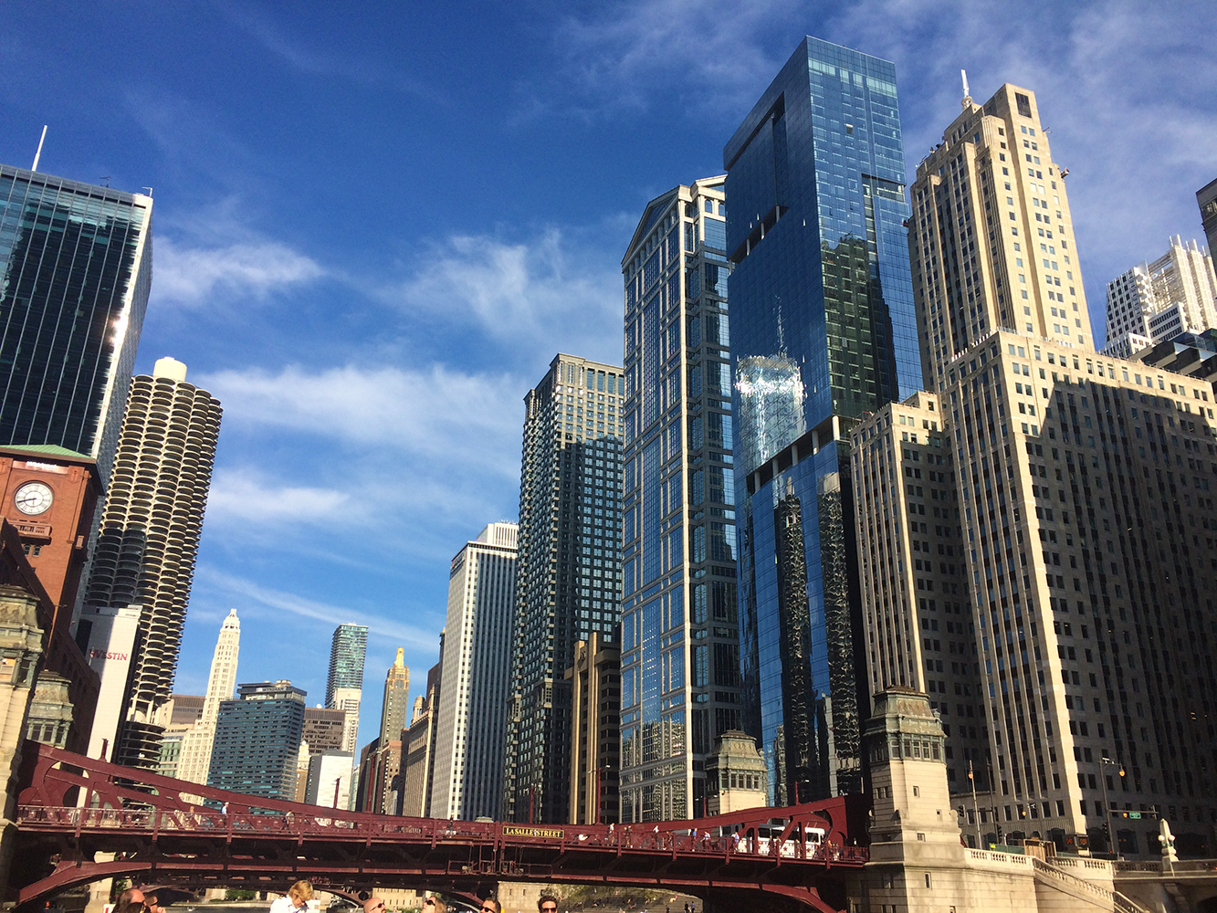 River view of Chicago canyon of skyscrapers with brown bridge in foreground Architectural Photography