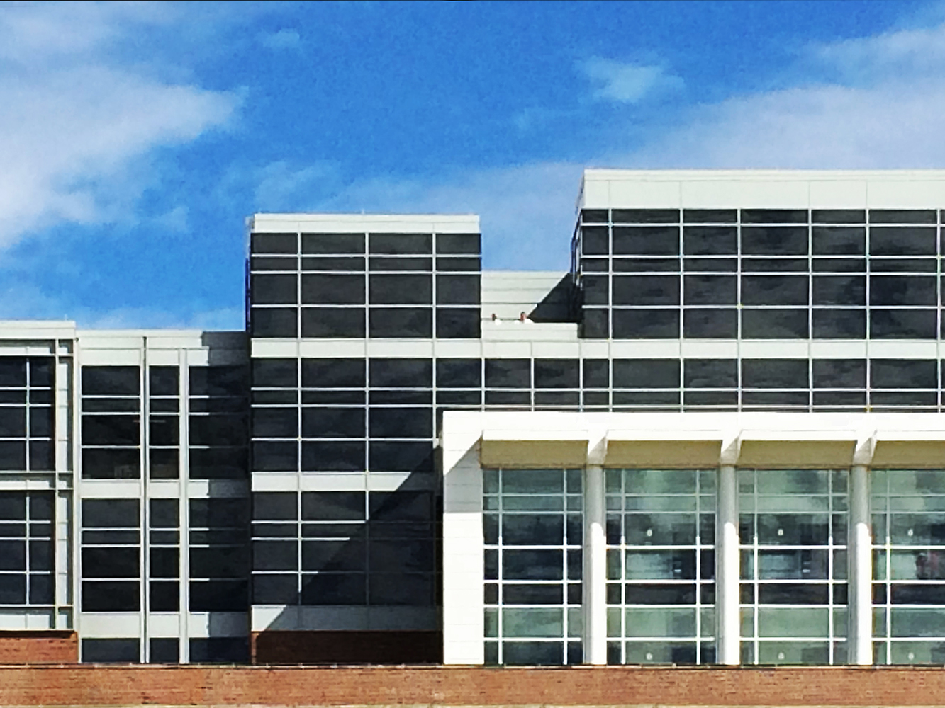 strait on shot of office building with a grid pattern Architectural Photography