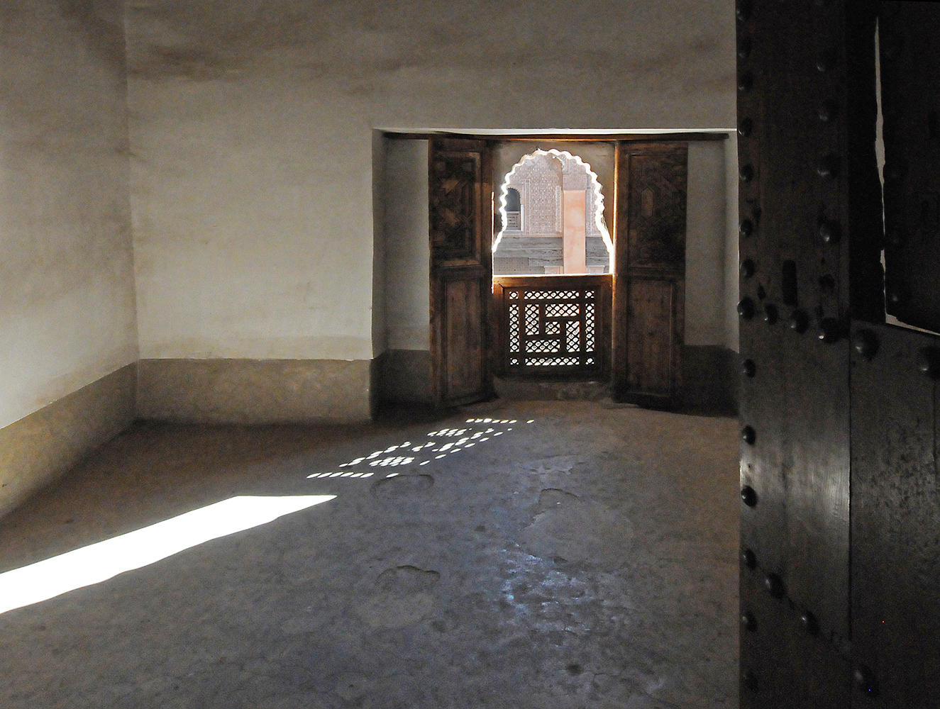 Madrassa room in Morocco with light streaming in window Architectural Photography