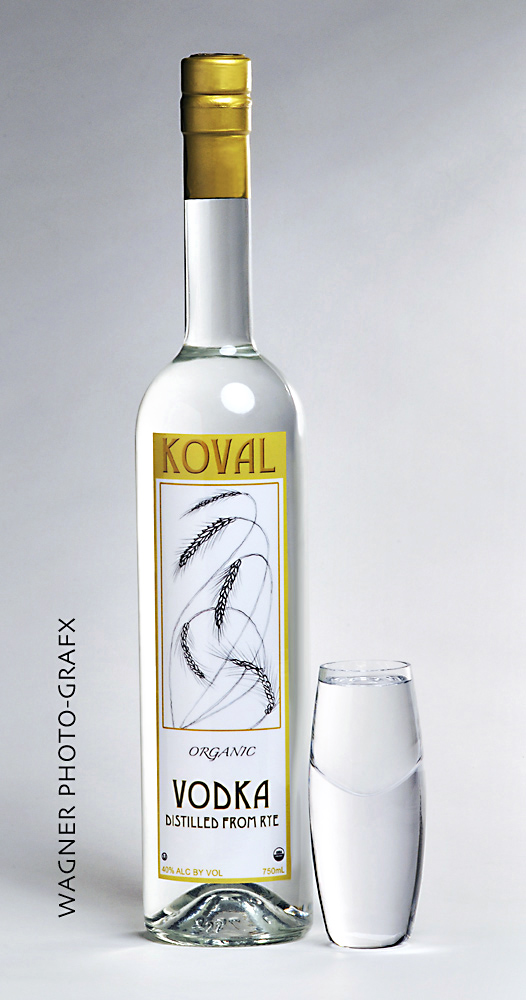 Product shot of tall Oval Vodka bottle and tall shot glass on white background Product Photography