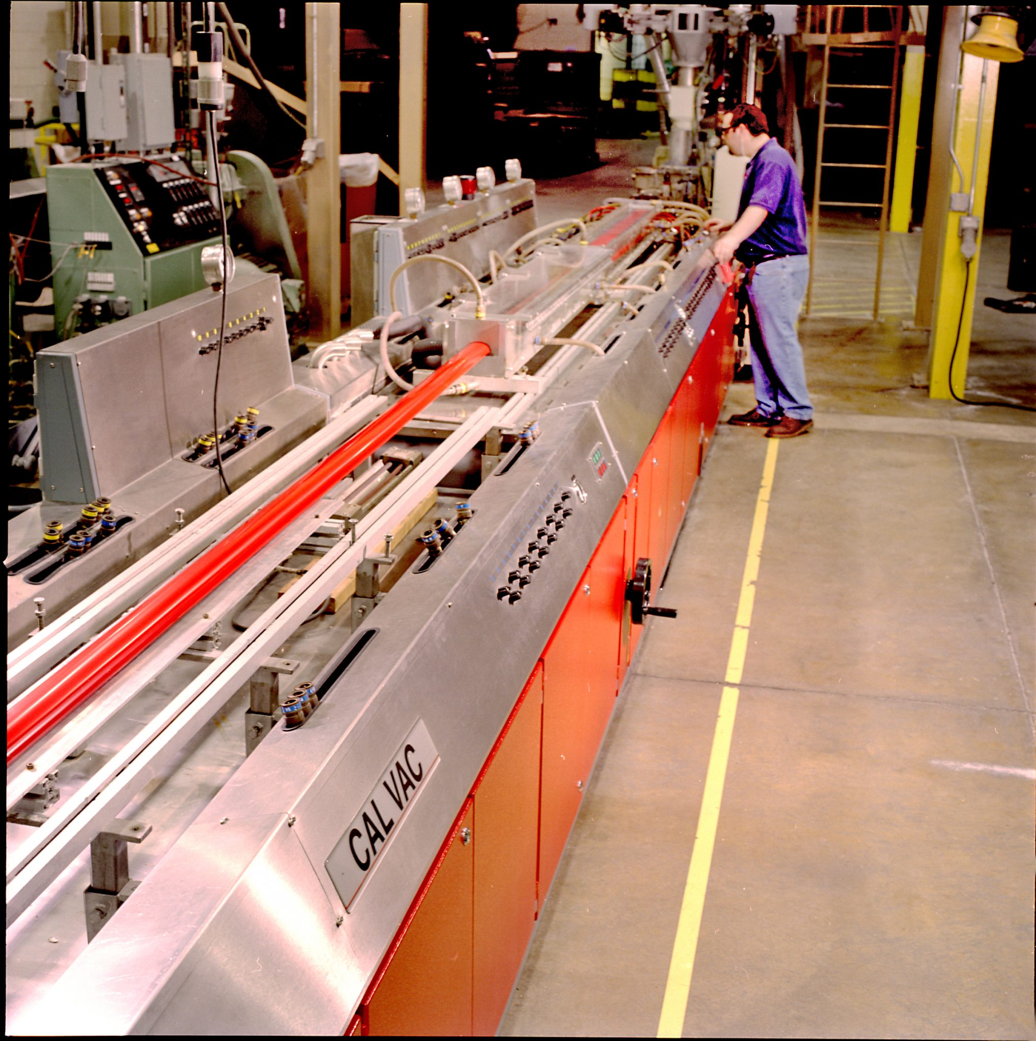 Industrial photo of an extruder line with worker Architectural Photography