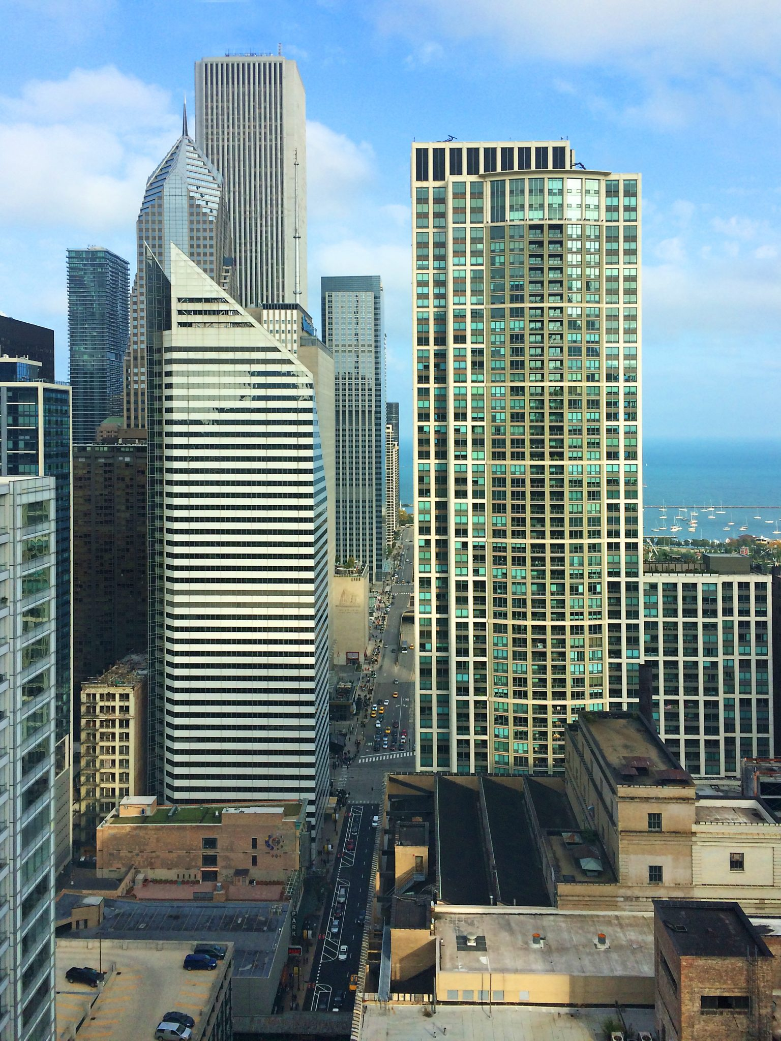 row of Chicago office buildings from midway up with Lake Michigan in background