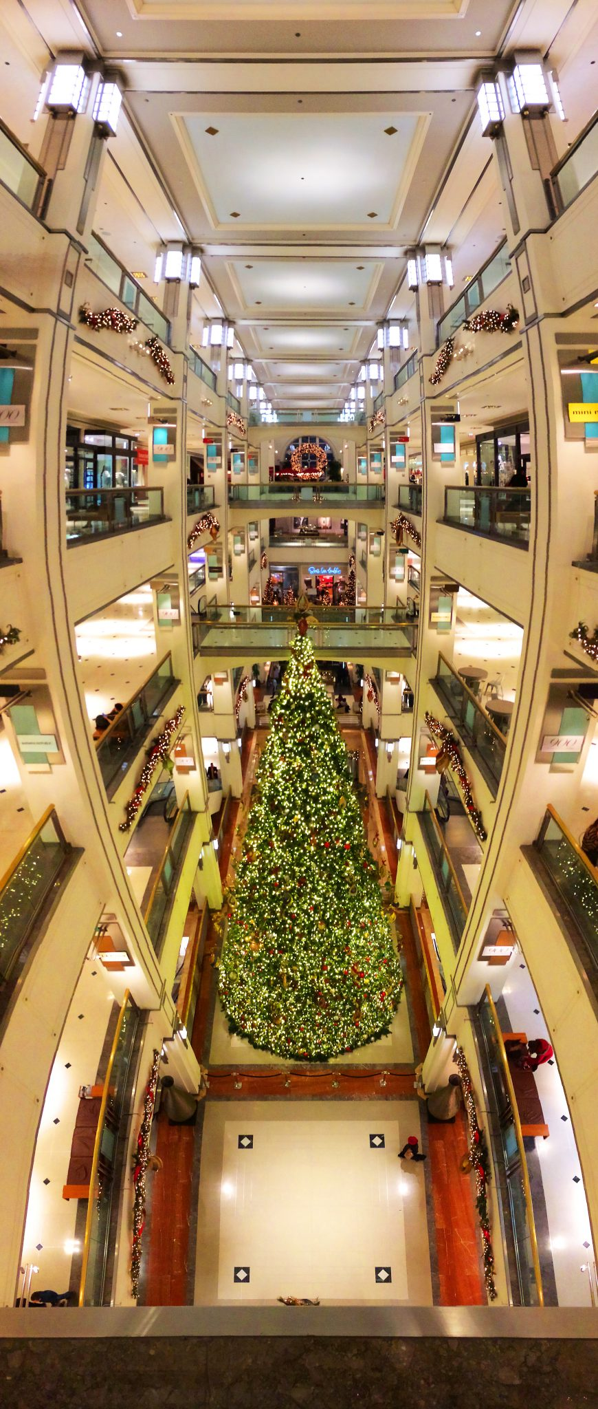 Wide angle view of Christmas tree from upper floor looking down into mall