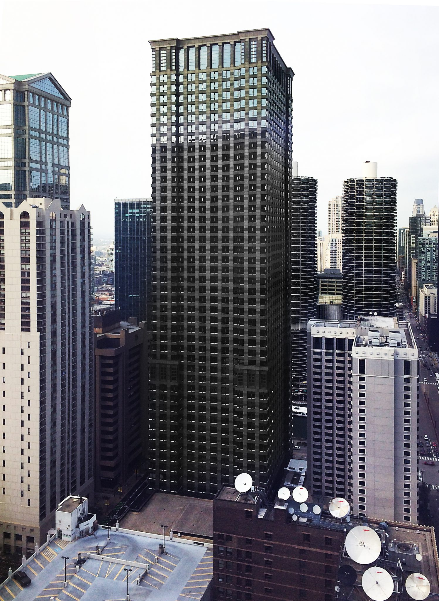 Leo Burnett Building Chicago viewed from mid point framed by other buildings