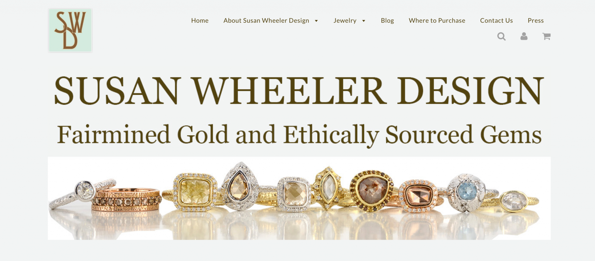 Jewelry web banner with horizontal line of fancy rings with reflections
